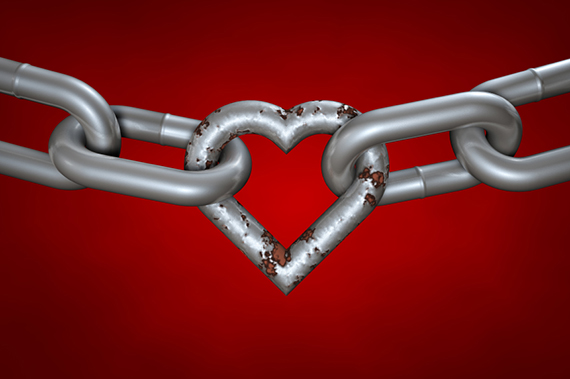 Chain with rusty heart on red background. Even rusty, the hart is still important part of the love chain. Clipping path included.