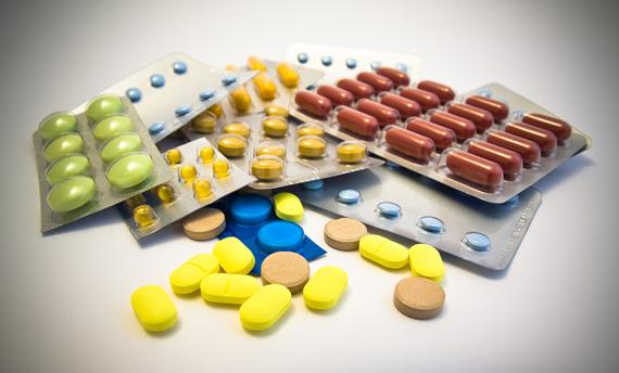 multi coloured pills on white background