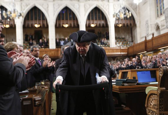 Liberal MP Mauril Belanger is given a standing ovation as he makes his way to the Speaker's Chair in the House of Commons Ottawa to preside over the House of Commons Wednesday, serving as honorary Speaker in a tribute organized by his fellow MPs following his diagnosis with ALS last November, in Ottawa Wednesday March 9, 2016. THE CANADIAN PRESS/Fred Chartrand