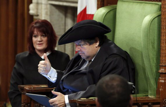 Liberal MP Mauril Belanger gives a thumbs-up as he sits in the Speaker's Chair to preside over the House of Commons Wednesday, serving as honorary Speaker, in a tribute organized by his fellow MPs following his diagnosis with ALS last November, in Ottawa Wednesday March 9, 2016. THE CANADIAN PRESS/Fred Chartrand