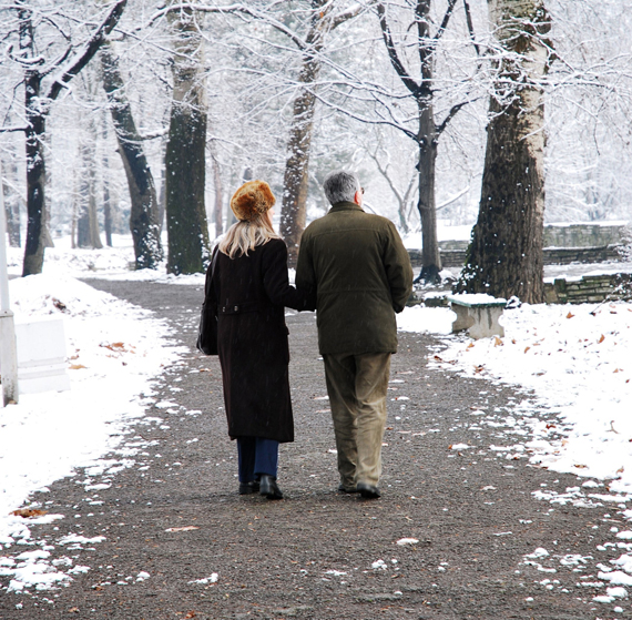 Senior couple walking in park at winter. (Photo illustration by Shutterstock)