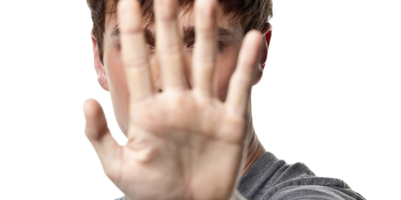 Young Man Hiding Behind Hand