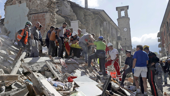Rescuers carry a stretcher following an earthquake in Amatrice, central Italy, Wednesday, Aug. 24, 2016. A strong earthquake in central Italy reduced three towns to rubble as people slept early Wednesday, with reports that as many as 50 people were killed and hundreds injured as rescue crews raced to dig out survivors. (AP Photo/Alessandra Tarantino)