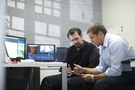 """10/7/2015 - Boston, MA - Akili - Eddie Martucci, cq, right, the CEO of Akili, cq, talks about Akili's video game """"Project: EVO"""" with Jeff Bower, cq, Akili's director of data science. Akili is a company that seeks to create clinically-validated cognitive therapeutics, assessments, and diagnostics that look and feel like high-quality video games. Topic: xxSTATvideogame. Story by Alissa Ambrose/Globe Staff. Dina Rudick/Globe Staff."""