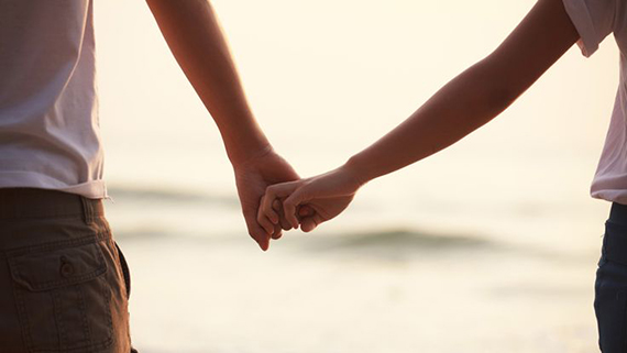 Close up of couple holding hands; Shutterstock ID 127361729; PO: Brandon for Trending