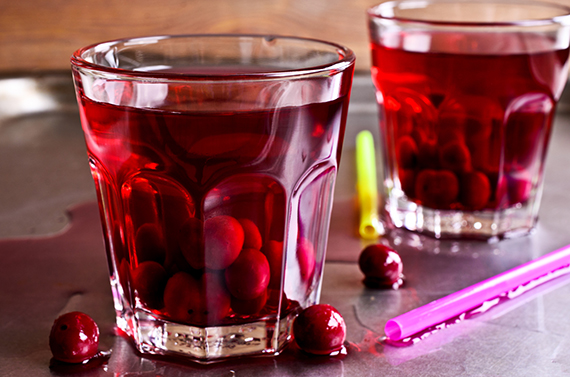 Cherry compote in glass beakers on a metal surface