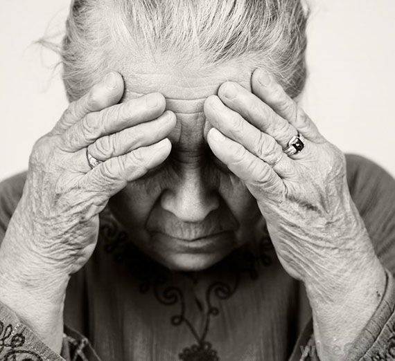 elderly-woman-with-hands-to-her-head